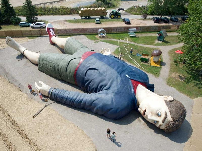 Workers are busy next to a figure of Gulliver at amusement park 'Gulliver's World' in Pudalga on Usedom, Germany. (AP Photo)