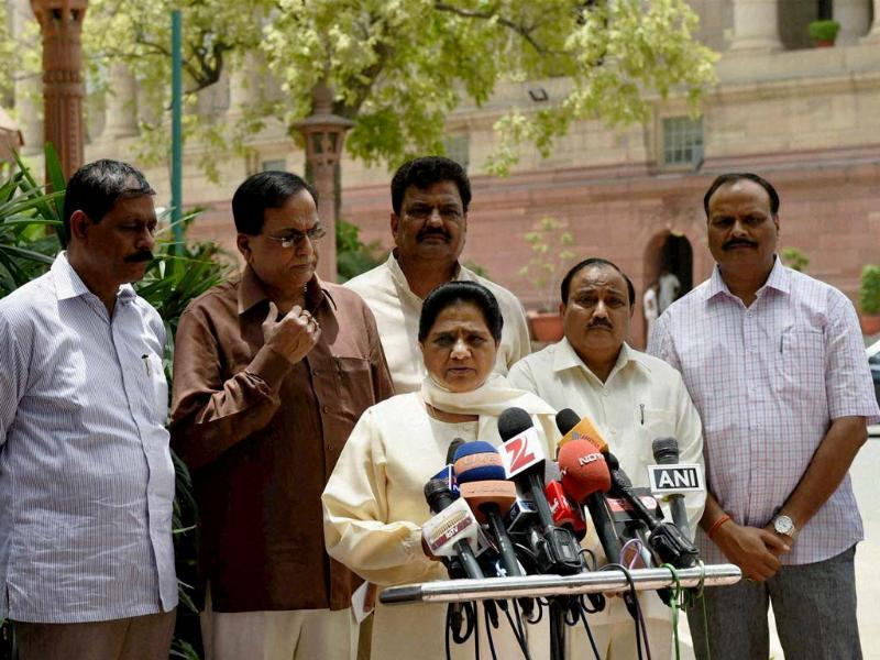 BSP Supremo Mayawati flanked by party leaders reacts on the rail budget at Parliament House in New Delhi. (PTI photo)