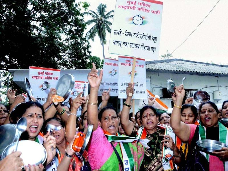 NCP women workers protest against railway budget outside BJP office in Mumbai. (PTI Photo)