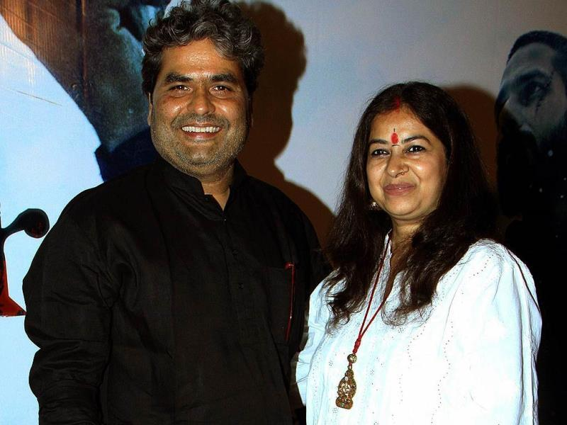 Vishal Bhardwaj arrives for the trailer launch of Haider with his wife Rekha. (AFP Photo)