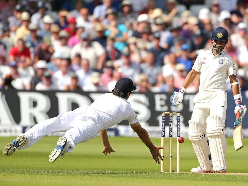 Ajinkya Rahane and Alastair Cook during play on day 1 of the first cricket test match between England and India at Trent Bridge in Nottingham, central England. (AFP Photo)