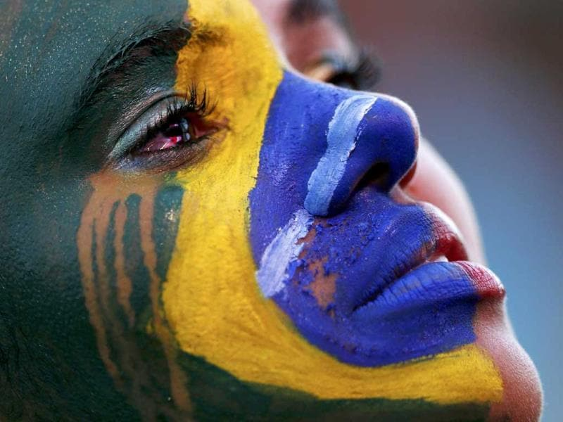 A Brazil fan cries as she watches the 2014 World Cup semi-final between Brazil and Germany at a fan area in Brasilia. (Reuters)