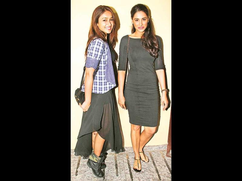 Ileana D'Cruz and Nargis Fakhri, co-stars in a recent film, attended a movie screening in the city. (HT Photo)