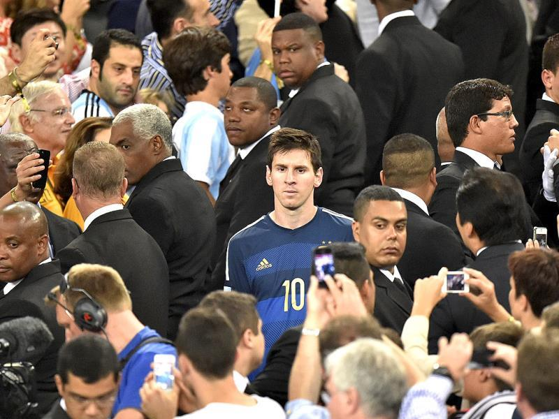 Spectators take photos of Argentina's Lionel Messi as he goes up to get his runners-up medal after the Fifa World Cup final match between Germany and Argentina at the Maracana Stadium in Rio de Janeiro, Brazil. (AP Photo)