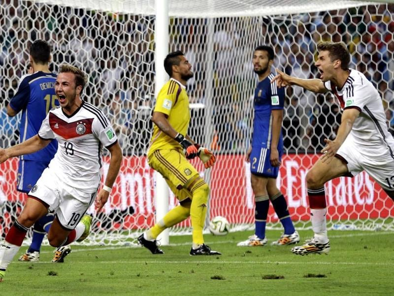 Germany's Mario Goetze, left, celebrates after scoring the opening goal during the Fifa World Cup final between Germany and Argentina at the Maracana Stadium in Rio de Janeiro, Brazil. (AP Photo)