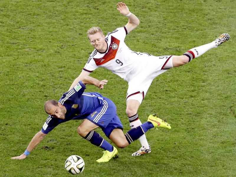 Germany's Andre Schuerrle and Argentina's Pablo Zabaleta fight for the ball during the Fifa World Cup final match between Germany and Argentina at the Maracana Stadium in Rio de Janeiro, Brazil. (AP Photo)