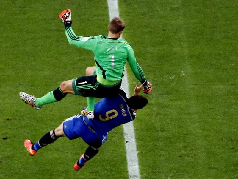 Germany's goalkeeper Manuel Neuer falls over Argentina's Gonzalo Higuain during the Fifa World Cup final match between Germany and Argentina at the Maracana Stadium in Rio de Janeiro, Brazil. (AP Photo)