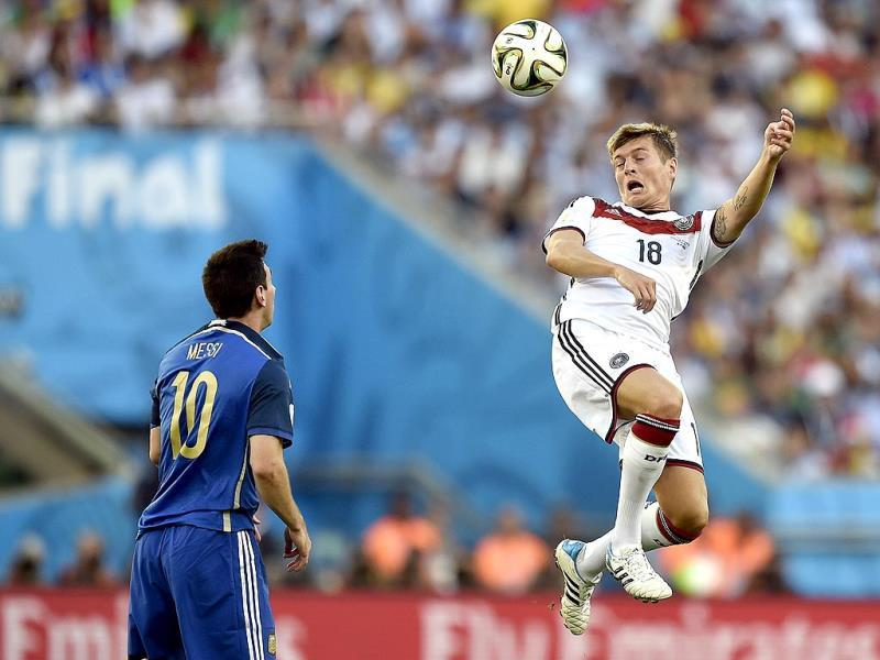 Germany's Toni Kroos (18) rises above Argentina's Lionel Messi (10) to head the ball during the Fifa World Cup final match between Germany and Argentina at the Maracana Stadium in Rio de Janeiro, Brazil. (AP Photo)