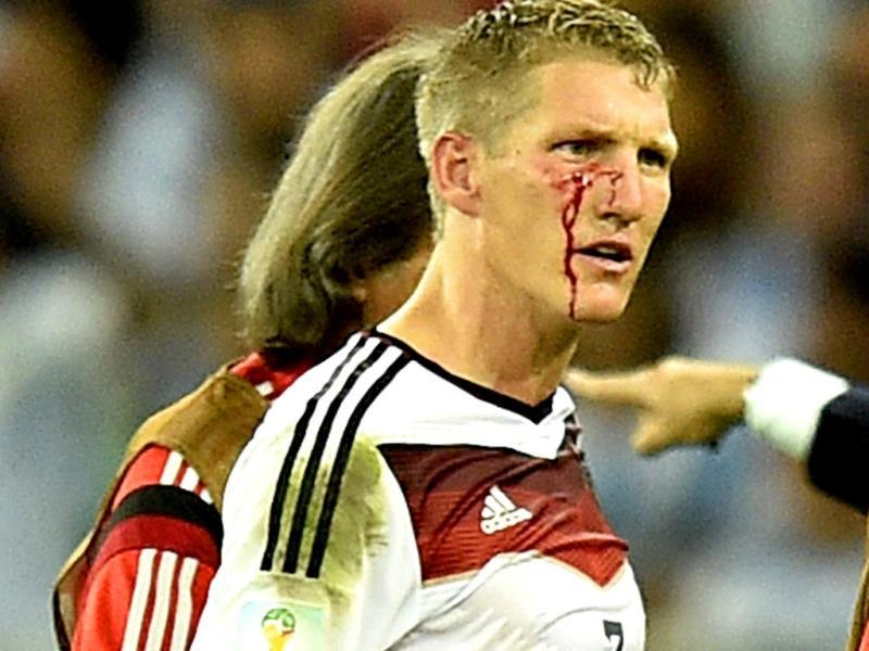 Germany's Bastian Schweinsteiger reacts as he comes off the pitch after getting injured during the Fifa World Cup final match between Germany and Argentina at the Maracana Stadium in Rio de Janeiro, Brazil. (AP Photo)