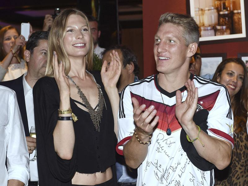 Germany's Bastian Schweinsteiger and his girl friend Sarah Brandner attend the party of the German soccer federation after Germany beat Argentina 1-0 after extra-time in the soccer World Cup final on July 13, 2014. (AP Photo/DFB, Markus Gilliar)