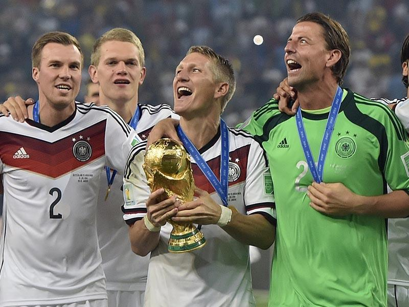 Germany's Bastian Schweinsteiger celebrates with the trophy after the World Cup final soccer match between Germany and Argentina at the Maracana Stadium in Rio de Janeiro, Brazil on July 13, 2014. (AP Photo/Martin Meissner)