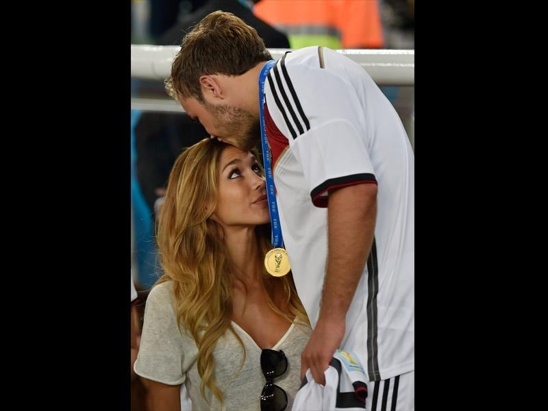 Germany's Mario Goetze kisses his girlfriend Ann-Kathrin Broemmel after the football World Cup final between Germany and Argentina at the Maracana Stadium on July 13, 2014. (AP Photo/Martin Meissner)
