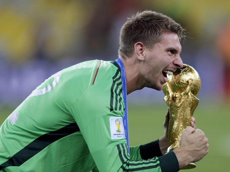 Germany's goalkeeper Ron-Robert Zieler celebrates with the World Cup trophy following their 1-0 victory over Argentina after the World Cup final between Germany and Argentina in Rio de Janeiro, Brazil on July 13, 2014. (AP Photo/Natacha Pisarenko)