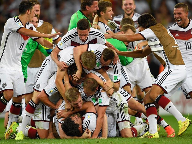 Germany's players pile up on top of each other as they celebrate after winning the World Cup final football match between Germany and Argentina 1-0 following extra-time at the Maracana Stadium in Brazil on July 13, 2014. (AFP/Odd Andersen)