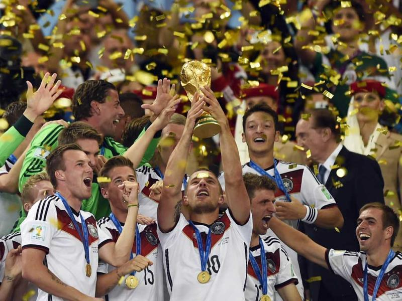 Germany's players celebrate with the World Cup trophy after winning the 2014 FIFA World Cup final football match against Argentina, 1-0 following extra-time at the Maracana Stadium in Rio de Janeiro, Brazil. (AFP Photo)