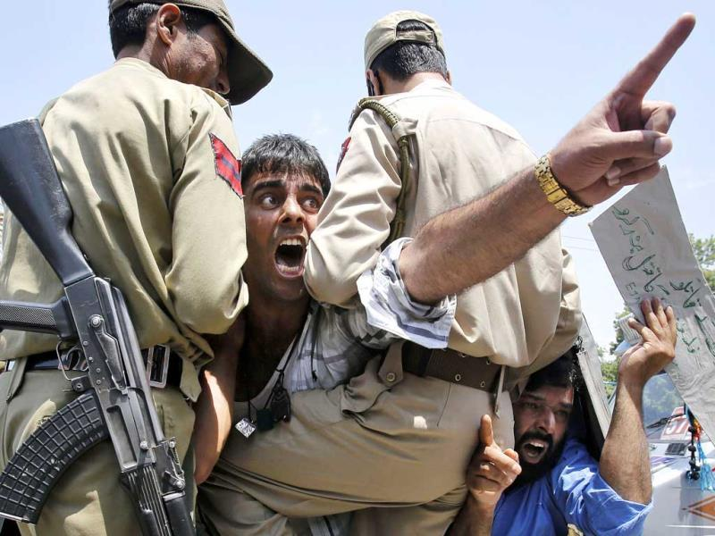 Kashmiri protesters shout slogans against Israel from inside a police vehicle after they were detained during a protest in Srinagar. (AP Photo)