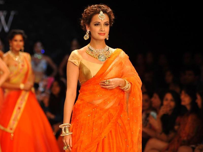 Actor Dia Mirza displays jewellery by Shobha Shringar Jewellers during the IIJW in Mumbai on July 14, 2014.