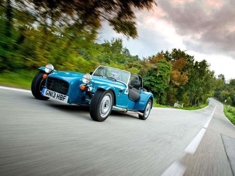 The Caterham Seven 160 €22,600/$30,000 : Low on power - it's only got a 660cc three-cylinder engine - but big on fun, the Seven 160 tries and succeeds to recapture the charm of the original Lotus 7 from the 1950s. It even has a live rear axle and skinny tires so that it'll drift around corners even at low speeds. And it comes with a roof. Photo:AFP