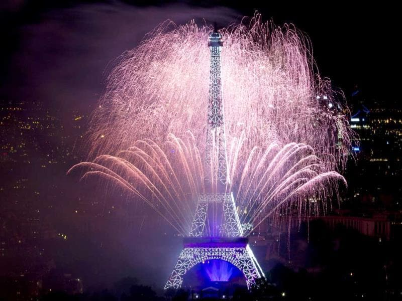 Fireworks burst around the Eiffel Tower in Paris as part of France's annual Bastille Day celebrations. (AFP Photo)