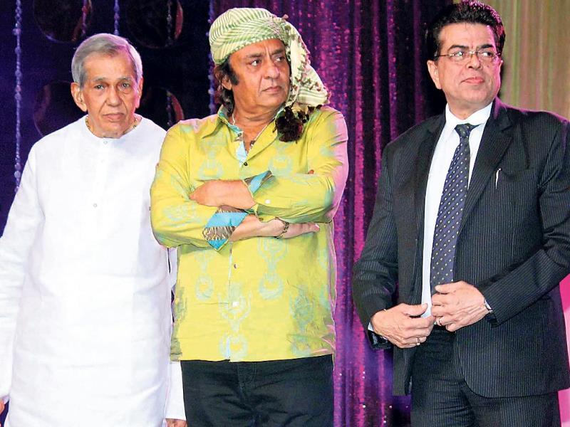 Actor Ranjeet, wearing his trademark keffiyeh and Mukesh Sharma attended an event in the city.(Photo: yogen shah)