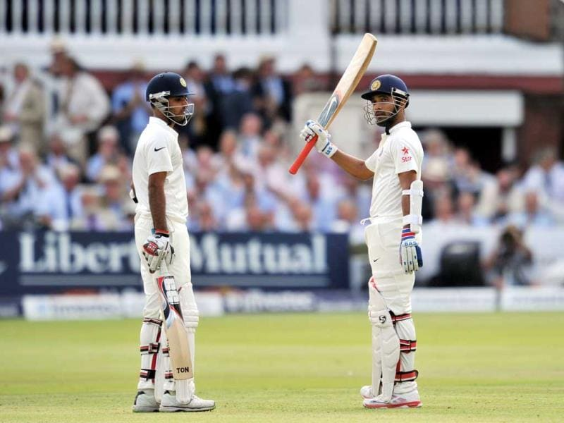 Ajinkya Rahane (R) celebrates his half century during the first day of the second Test against England at Lord's cricket ground in London, England. (AFP Photo)