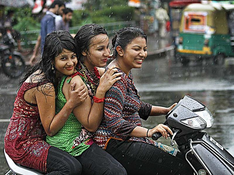 Girls enjoy sudden rain at Connaught Place. The showers brought much-needed relief from the heat and humidity (Virendra Singh Gosain/HT Photo)