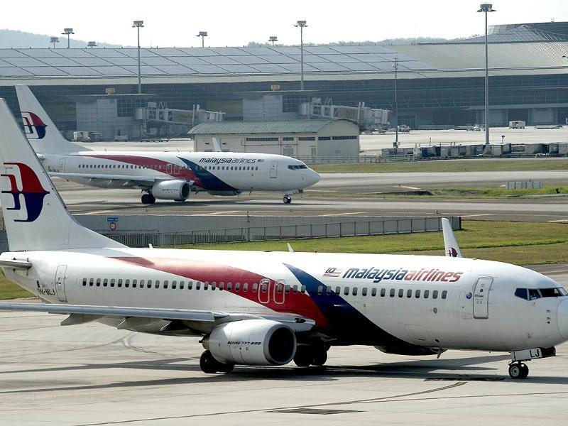 Malaysia airlines planes are seen on the tarmac at the Kuala Lumpur International Airport. (AFP Photo)