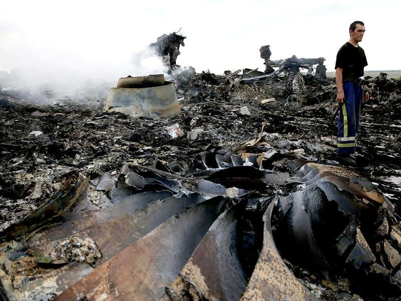An Emergencies Ministry member walks at the site of a Malaysia Airlines Boeing 777 plane crash.