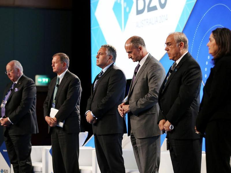 From (L-R), Rio Tinto CEO Sam Walsh, SEB Chairman Marcus Wallenberg, treasurer of Australia Joe Hockey, GE Global Growth and Operations CEO John Rice, OECD Secretary-General Angel Gurria and Energy Australia MD Catherine Tanna hold a minute silence for the victims of MH17. (AFP)