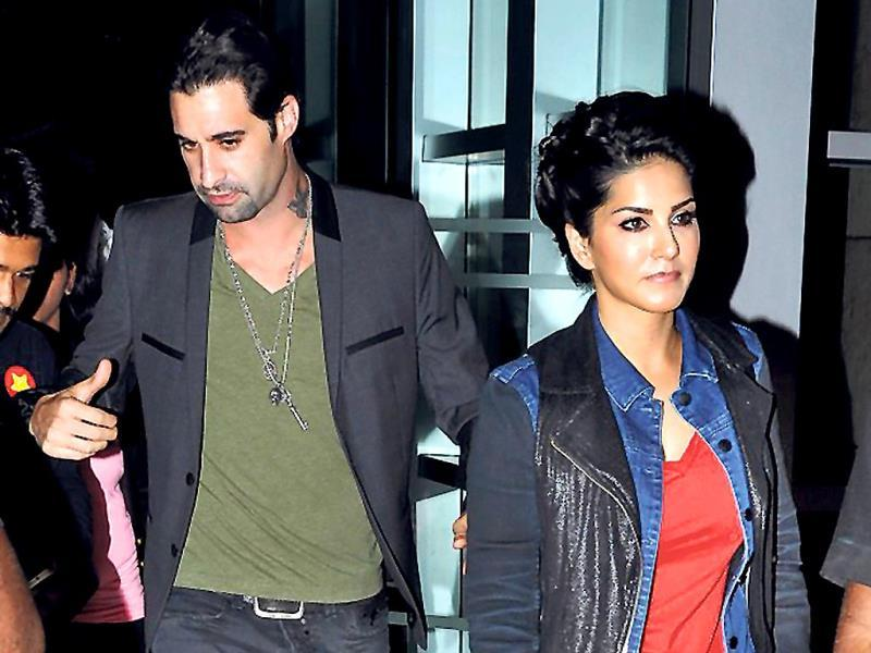Sunny Leone and her husband Daniel Weber were seen exiting a suburban five-star on Wednesday night. (Photo: Viral Bhayani)