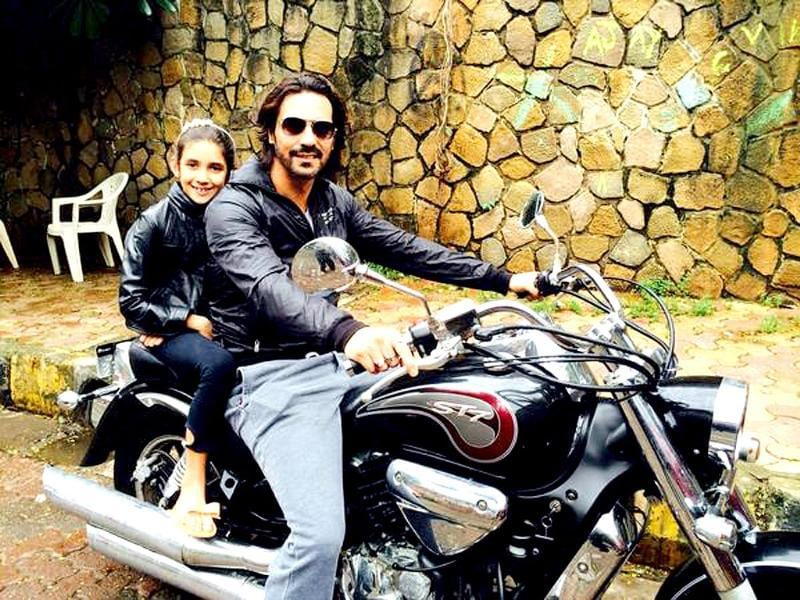Arjun Rampal with daughter Myra as they are on their way to get haircuts.