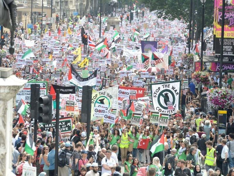 Thousands of protesters march through Whitehall in central London, to call for an end to Israeli military action in Gaza and