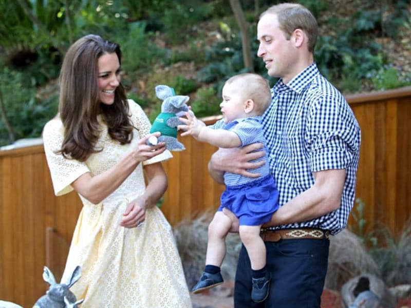 Doting papa, Prince William holds his little bag of cuteness as the beautiful mommy Kate Middleton gives him a toy bilby during a visit to the Bilby Enclosure at Taronga Zoo in April this year in Sydney, Australia. (Getty Images)