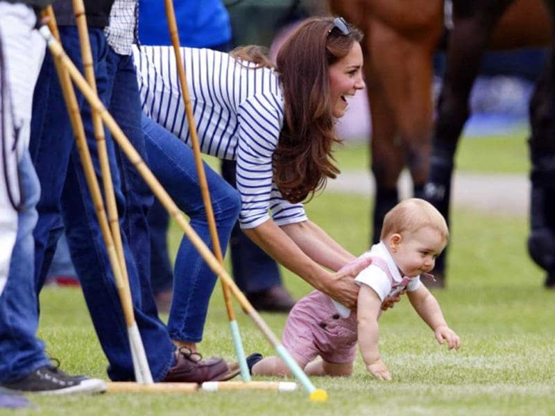 On his play-day out, Duchess of Cambridge and little prince watch papa William and uncle Harry play in the Jerudong Trophy charity polo match at Cirencester Park Polo Club on June 15. We wish we could just reach out into our screens and grab him and snuggle him and cuddle him ... (Getty Images)