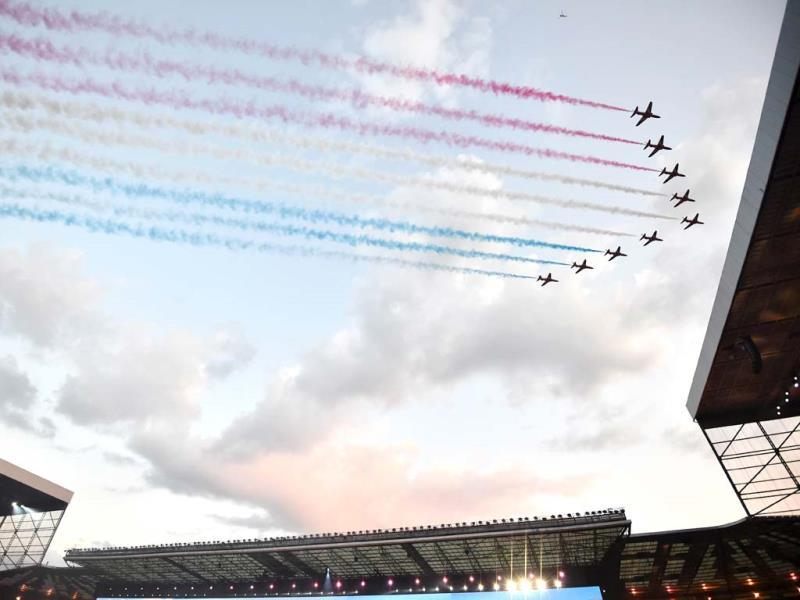 An aeronautics team flies past during the opening ceremony (AFP Photo)
