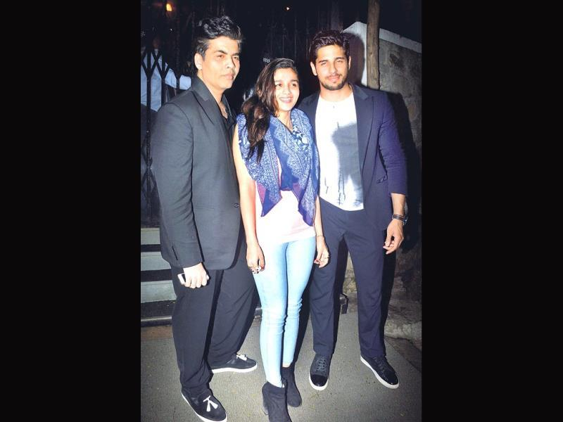 Karan Johar stepped out for dinner with Alia Bhatt and Sidharth Malhotra. While the men donned formals, Alia sported a casual look in jeans, a tank top and scarf.(Photo: Yogen Shah)