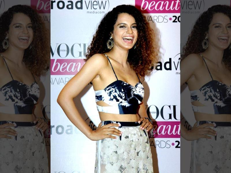 Actor Kangna Ranaut having a good time at the Vogue Beauty Awards 2014 in Mumbai on Tuesday. (PTI)