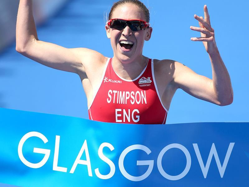 England's Jodie Stimpson celebrates after winning the women's Triathlon race at the Commonwealth Games Glasgow 2014(AP Photo)