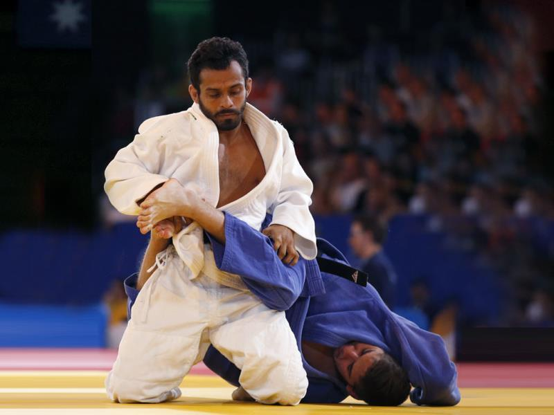 Navjot Chana of India, left, holds down Daniel Le Grange of South Africa during their men's 60 kg judo semifinal bout(AP Photo)