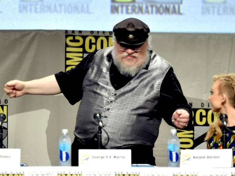 George RR Martin, the creator of the Game of Thrones universe, breaks into a jig on his cue.