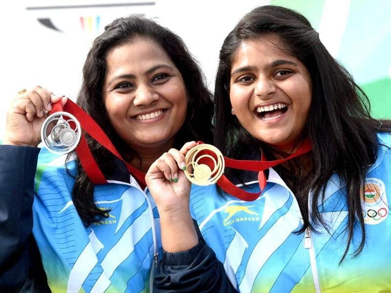 Gold medallist Rahi Sarnobat and silver medallist Anisa Sayyed with their medal at a medal ceremony after the Women's 25M Air Pistol during the Glasgow 2014 Commonwealth Games at the Clyde Auditorium in Glasgow,Scotland. (PTI photo)