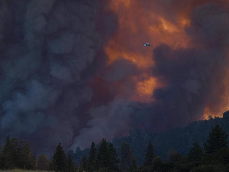 A spotter aircraft flies above the fast-moving wildfire called 'Sand Fire' burning near Plymouth. (Reuters)