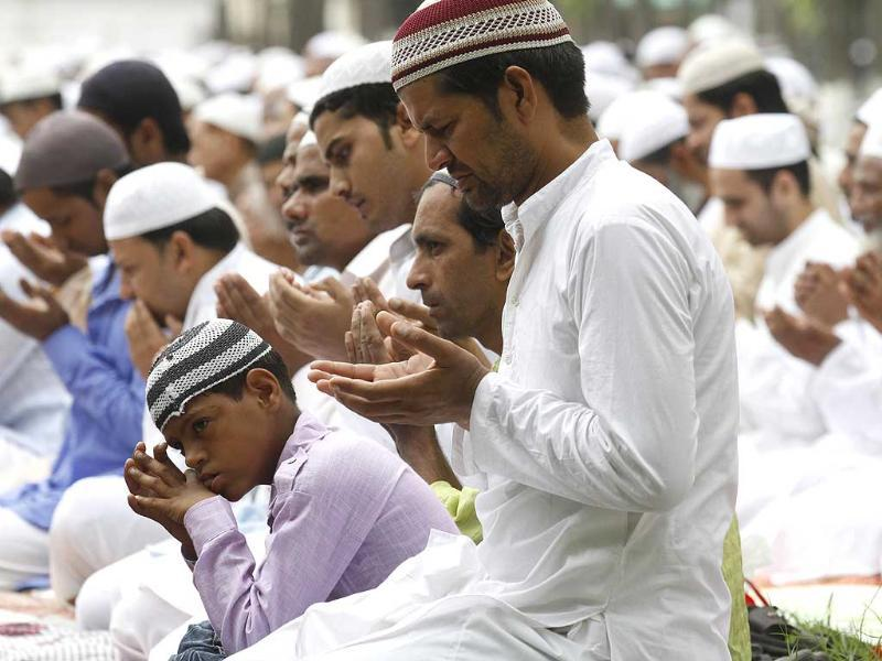 Muslims offer prayers as they celebrate the festival of Eid al-fitr, marking the end of Ramzan in Saharanpur. (Virendra Singh Gosain/HT photo)