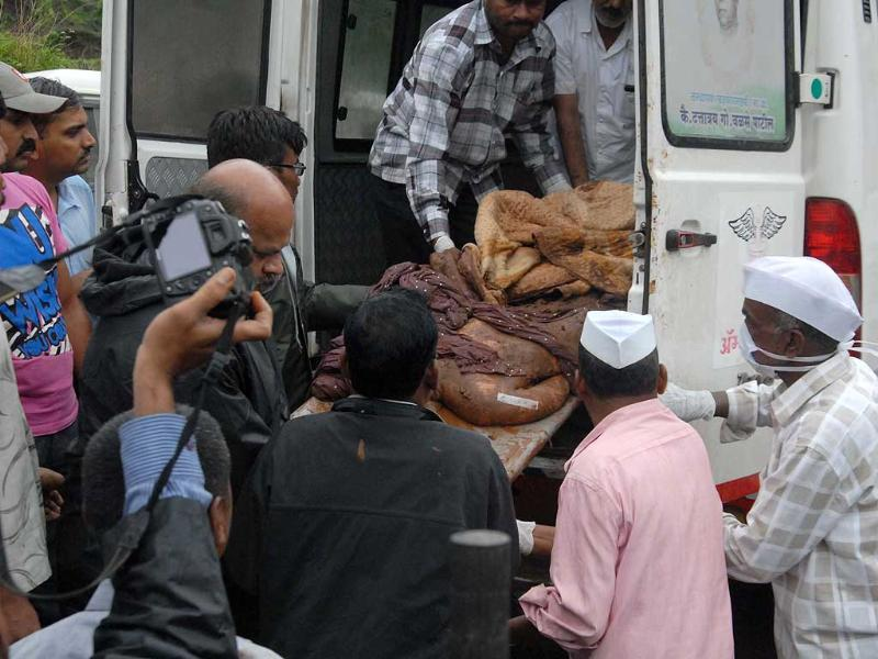 Man on a hospital stetcher after being pulled out of rubble in Malin village, Ambegaon near Pune. (HT Photo)