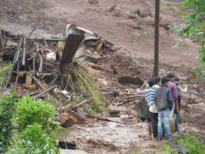 Over forty houses were buried in a landslide triggered by heavy rains at Malin village in Pune district, Maharashtra. (HT File Photo)