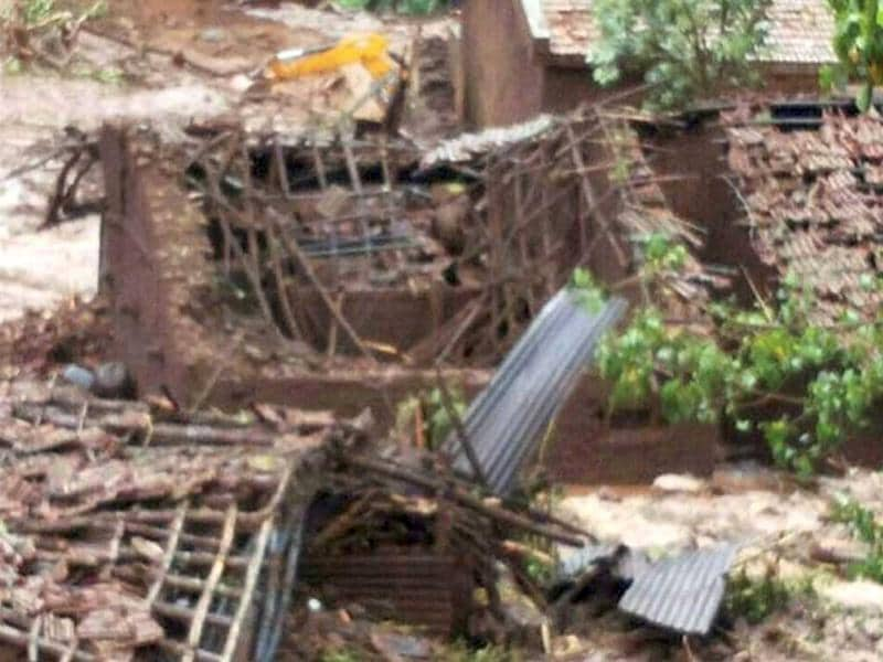 The damaged houses after a landslide triggered by heavy rains aLandslide in Ambegaont Malin village in Pune district, Maharashtra. (PTI Photo)