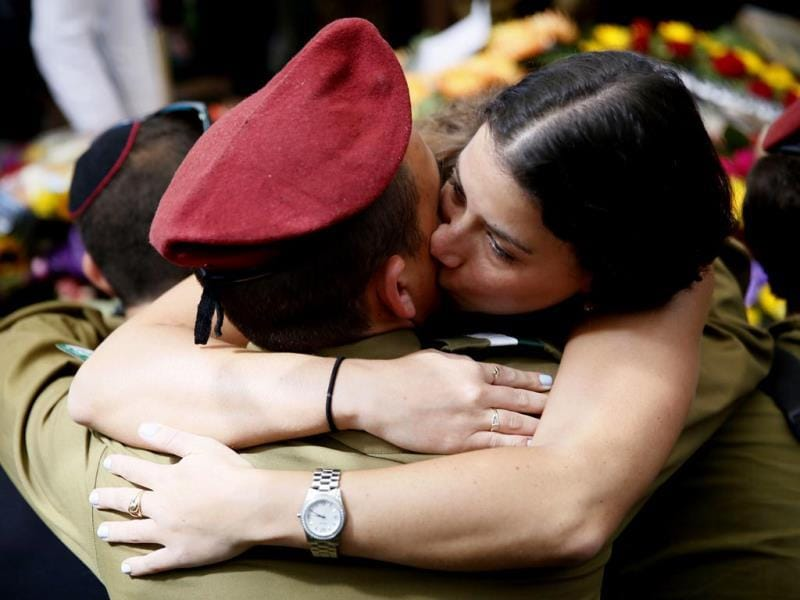 Comrades of 20-year-old Israeli Sgt. Guy Algranati, mourn during his funeral in the military section of the Kiryat Shaul cemetery in Tel Aviv . (AFP Photo)