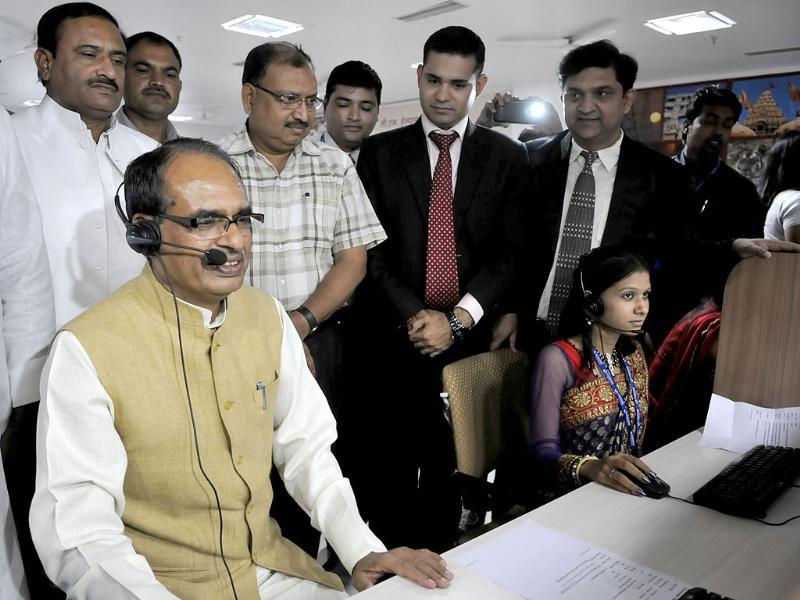 Chief minister Shivraj Singh Chouhan attends a call during inauguration of CM helpline in Bhopal. (Mujeeb Faruqui/HT photo)