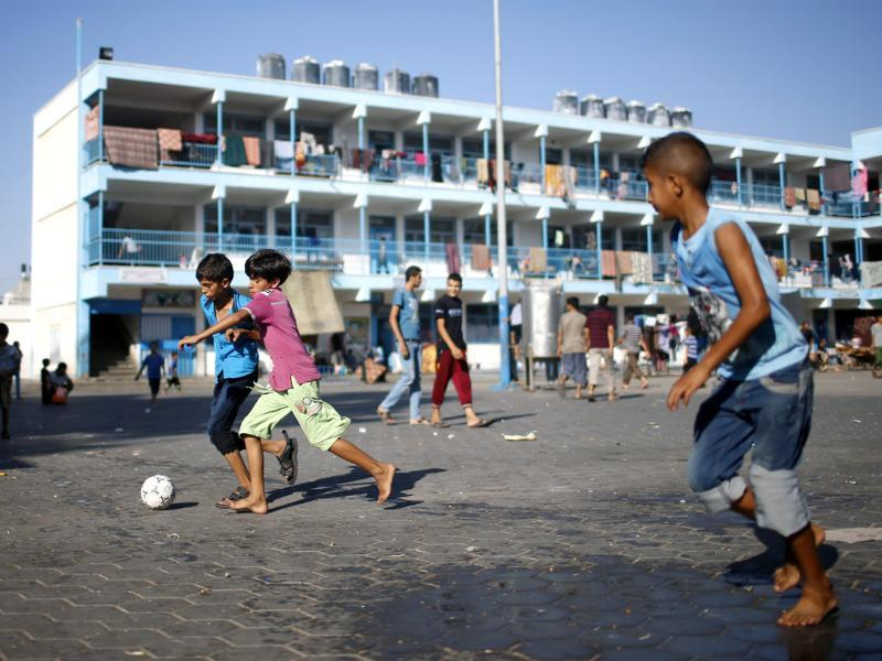 Palestinian boys, who fled houses following Israeli offensive, play soccer as they take refuge at a UN-run school in Jabaliya refugee camp in the northern Gaza Strip. The UN in Gaza is struggling to withstand a flood of almost a quarter of a million refugees into shelters that have repeatedly come under Israeli fire. (Reuters photo)