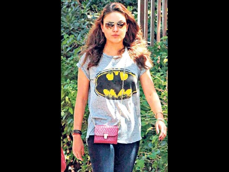 Actor Mila Kunis lounges around in a tee with the oh-so-cool Batman logo.